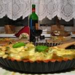Muszle ze szpinakiem i łososiem zapiekane w sosie pomidorowym